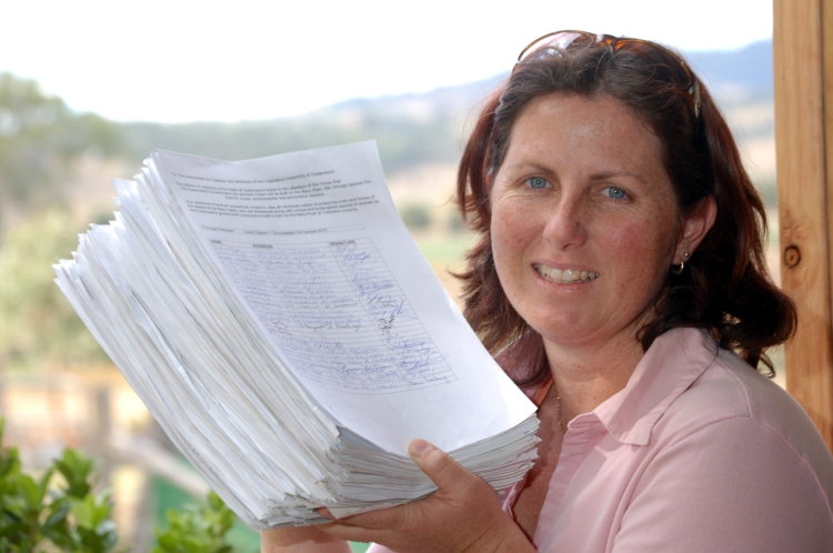 Melanie Larsen with the 15000 signatures against the Traveston Dam Melanie Larsen with the 15000 signatures against the Traveston Dam - Traveston Dam protest - June 2006 - Gympie Times collection