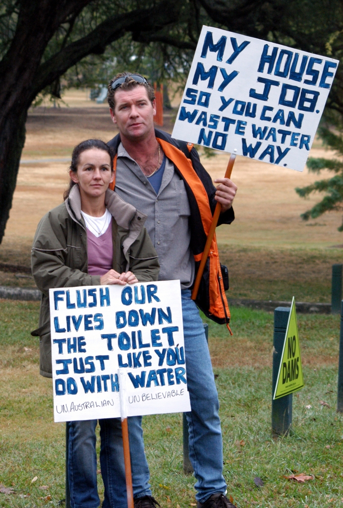 Marita and Clinton Wood turned up to the rally in Brisbane. The Woods will loose their house and jobs because of the Traveston Dam - Traveston Dam protest - June 2006 - Gympie Times collection