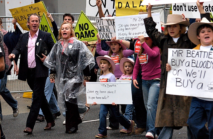 Ivan and Kate Molloy lead the Anti Dam parade in Brisbane - Anti Dam protesters head toward the Entertainment centre to the ALP state conference - Traveston Dam protest - June 2006 - Gympie Times collection