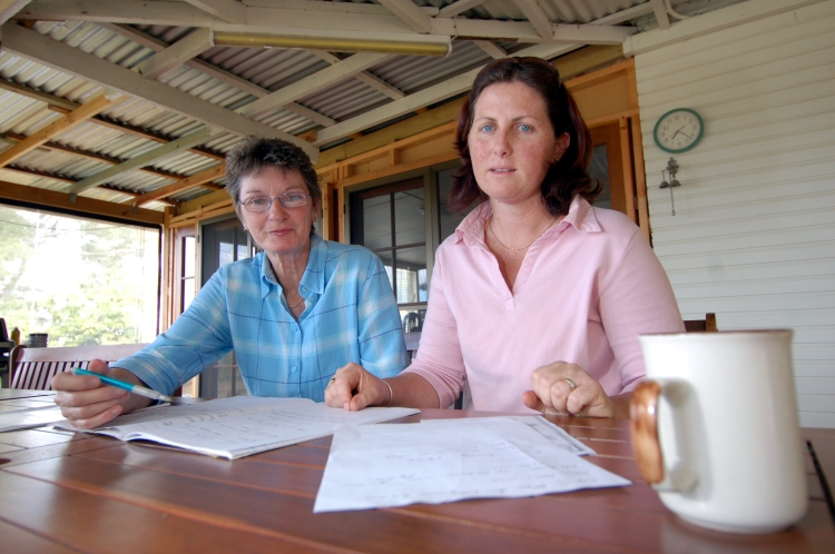 June Blighton and Melanie Larson organise buses for the Rally in Brisbane against the Dam Traveston Dam protest - June 2006 - Gympie Times collection