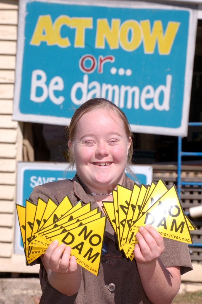 Vanessa holds up the No Dam stickers that are for sale for $1 Traveston Dam protest - May 2006 - Gympie Times collection